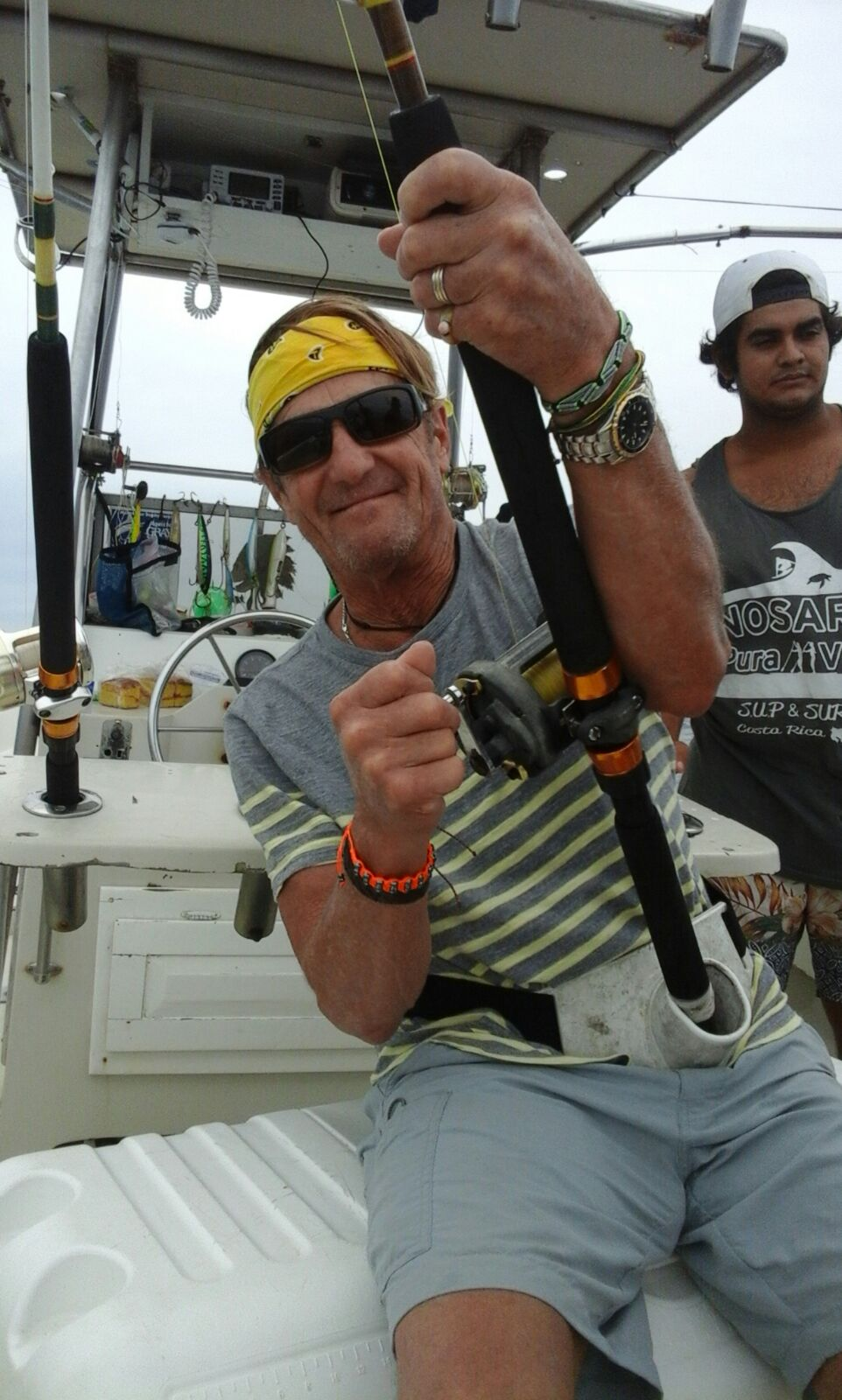 Big smiles for happy fisherman on the Cowboy 38,  during a private charter tour off the coast of Nosara, Costa Rica.