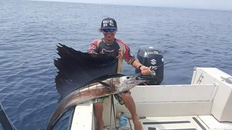 A sailfish poses for his picture right before release on board the Cowboy 38, during a private charter tour off the coast of Nosara, Costa Rica.